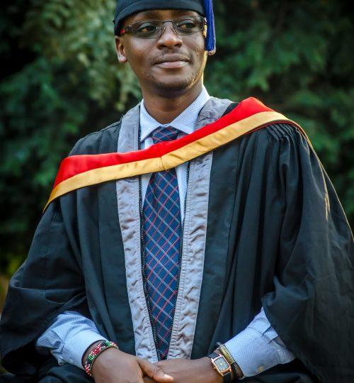 med-man-wearing-graduation-gown-2259997